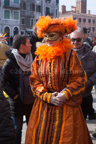 Woman dressed in Period Orange Costume at the Wenice Carnival Water Parade