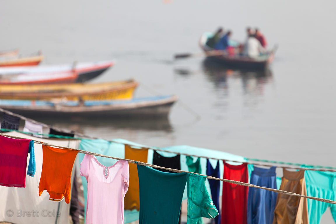 "Outdoor laundry (""Dhobi Ghat"") on the Ganges River, Varanasi, India. Workers wash the clothes by beating them on rocks, and t..."