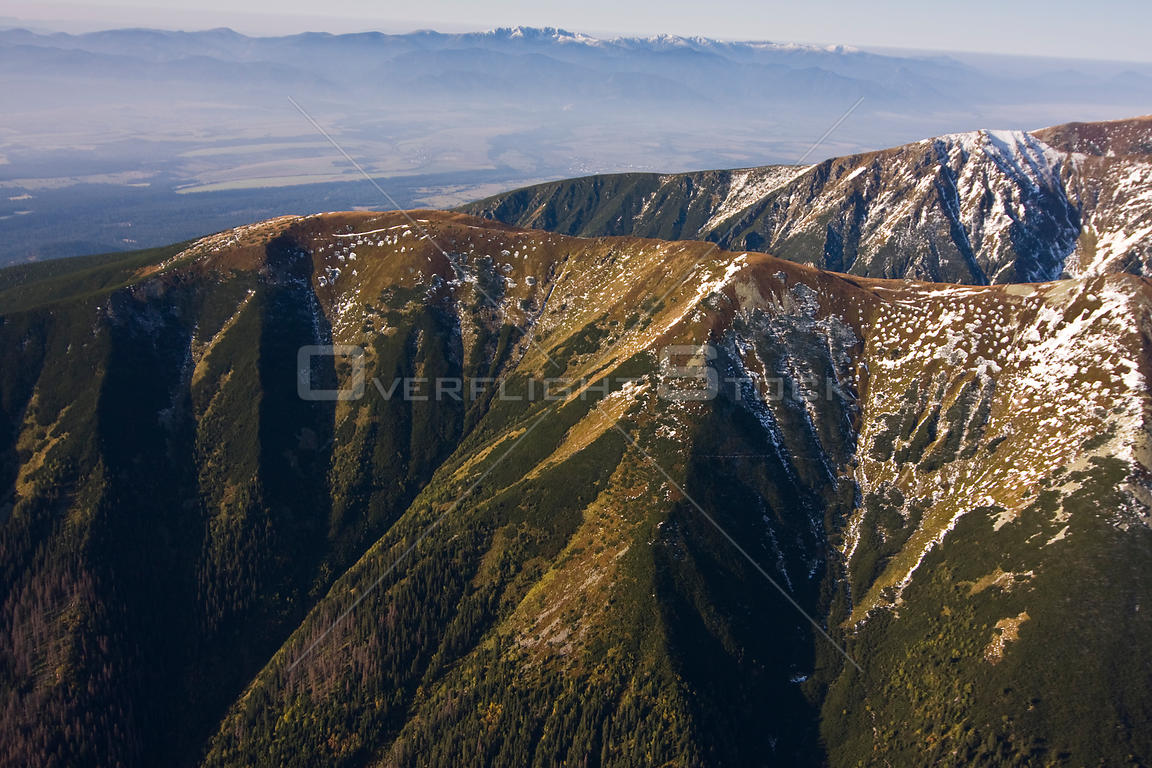 Aerial view of mountain ridges in the Western Tatras. The Low Tatras can bee seen in the distance. Slovakia, September 2008.