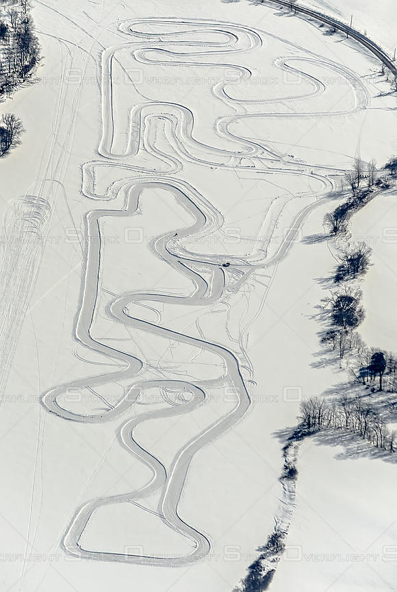 An ice-racing track on a frozen pond
