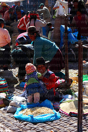Quechua women with daughter selling tarwi in Pisac market, Sacred Valley, Cusco Region, Peru