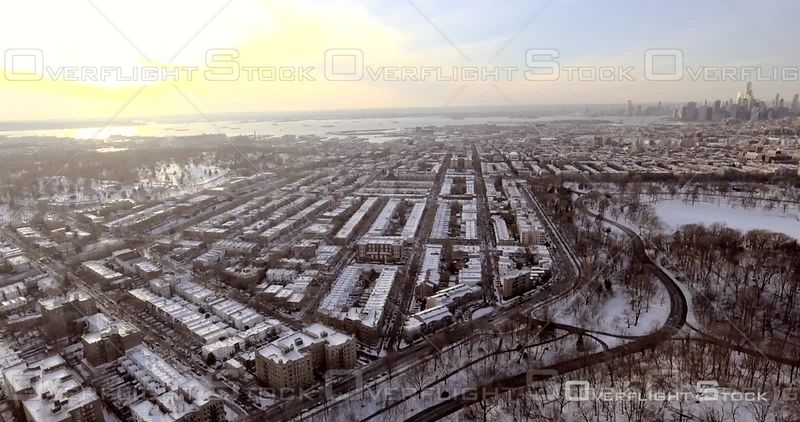 Aerial Over Brooklyn and Prospect Park Snowy Manhattan in Background NYC