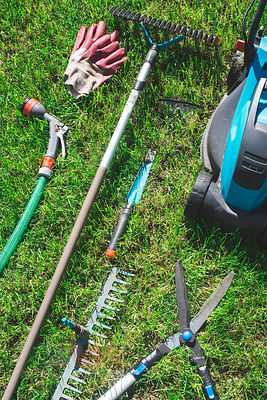 Gardening tools on a meadow