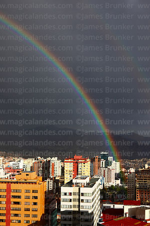 Rainbow over Sopocachi district in rainy season, La Paz, Bolivia