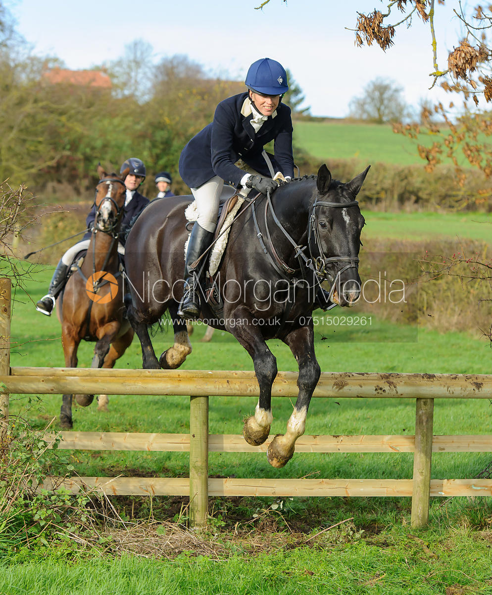 Katie Barber jumping a hunt jump