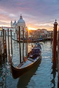 Gondola and Salute basilica at sunset, Venice, Italy