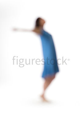 A dancing woman in a blue dress – shot from mid level.