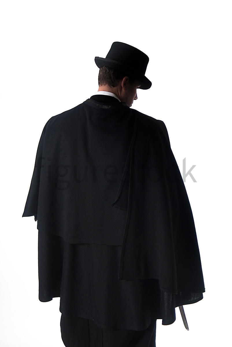 A Figurestock image of a mystery Victorian man in a cloak and hat, holding a knife, in silhouette - shot from eye level.