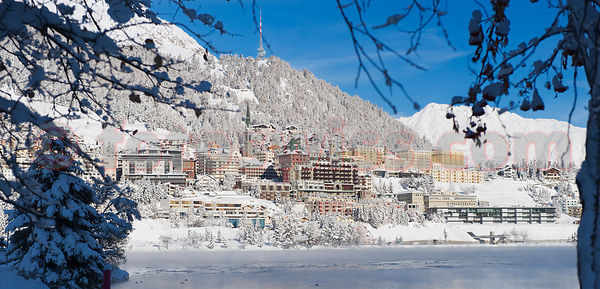 Saint St. Moritz in Winter. View of the City from the Lake. Top of the World Resort.
