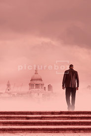 An atmospheric image of a mystery man standing on some steps near St Paul's Cathedral, London, England.