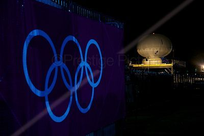 Olympic Broadcasting TV Transmiiter at Night with Illuminated Olympic Rings at the side