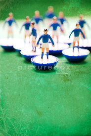 An atmospheric image of the players from a blue Subbuteo team.