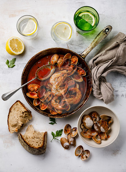 Cooked Vongole Clams with tomato sauce and parsley in cooking pan