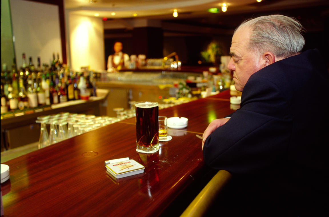 A man dozes at a bar on board the P&O Cruise Liner Oriana