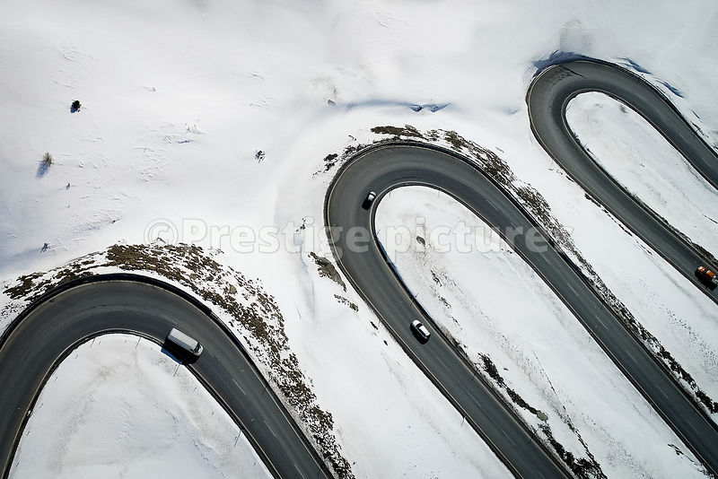 Aerial view of a twisting road in the snow in Switzerland