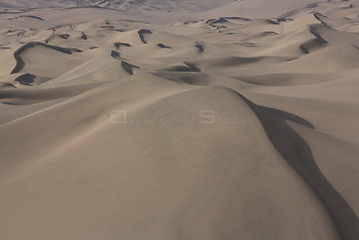 Aerial view of Nazca coastal desert with sand dunes in San Fernando National Reserve, Peru