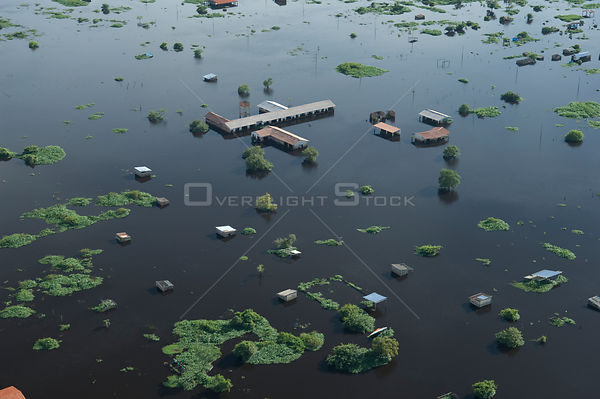 Aerial view of houses at the periphery of Trinidad city, capital of the Beni Department, during the 2008 flood of Mamoré Rive...