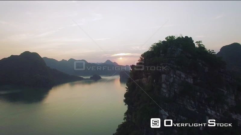 Sunset Above Lime Stone Island in Ha Long Bay Vietnam
