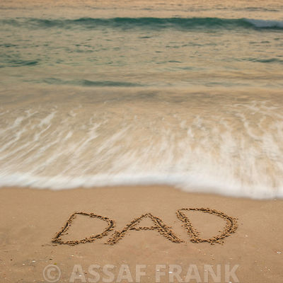 Sand writing - Word Dad written on beach