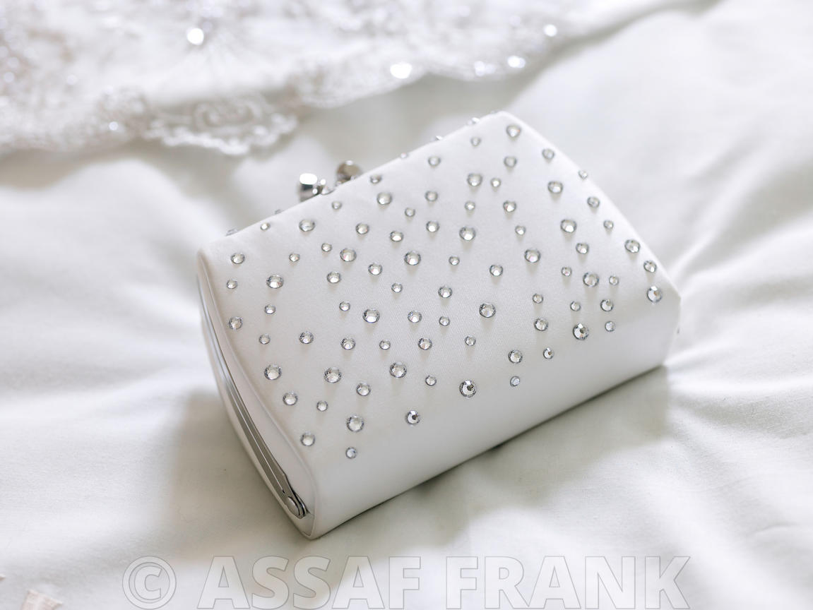 Close-up of wedding purse on bed