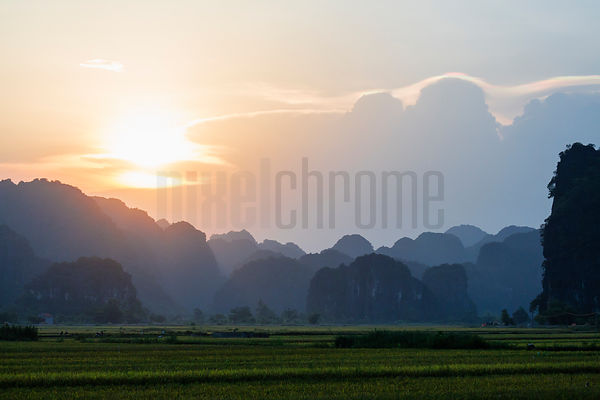 Sunset over the Rice Paddies with Approaching Storm