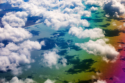 Cumulo Nimbus cloud and rainbow seen from an aeroplane window over the Argentinian coast. Argentina. February 2014