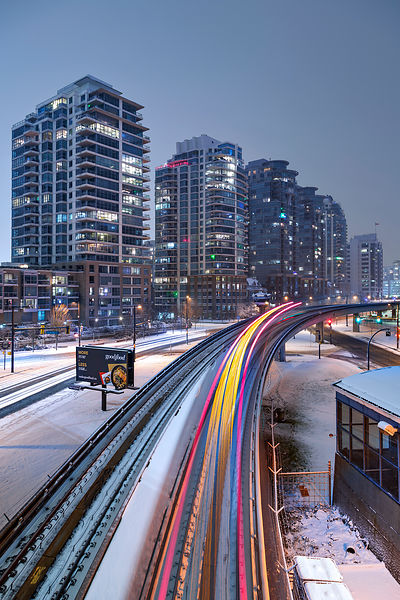 Skytrain Zipping Through Snow