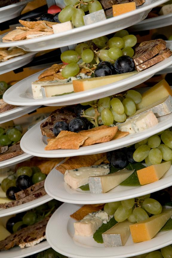 Platters of cheese and fruit waiting to be served