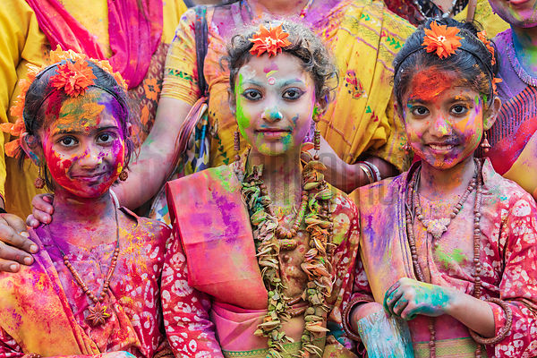 Portrait of Three Young Children Playing Holi at Golf Green Park in South Calcutta
