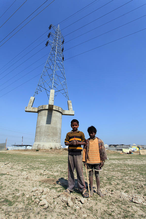 Kids goofing off in front of elevated power lines along the Ganges River, Allahabad, India.