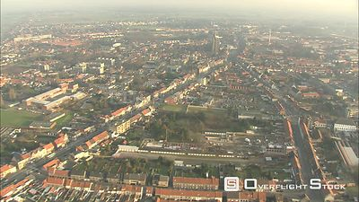 Flight over Eeklo, Belgium City Hall and Belfry on left
