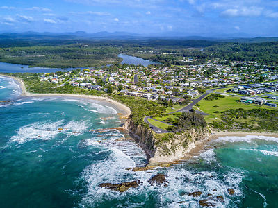 Tomakin aerial views of beaches and escarpment to the mountains in the far distance. Australia