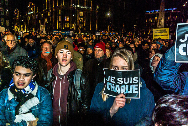 Amsterdam, Netherlands 2015-01-08: Young demonstrants among the crowd on the Dam
