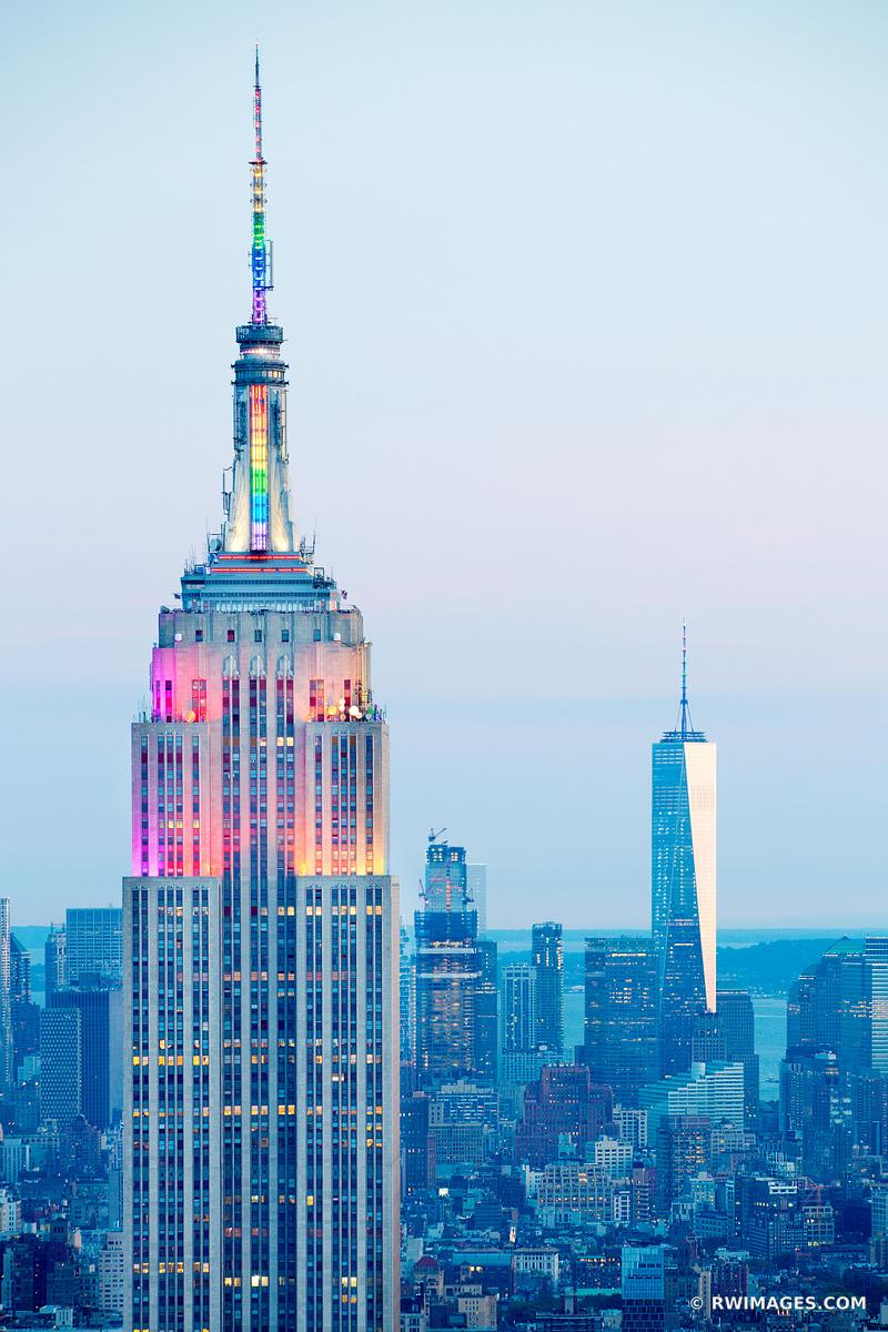 GAY PRIDE RAINBOW COLORS LIT EMPIRE STATE BUILDING MANHATTAN NEW YORK CITY EVENING VERTICAL