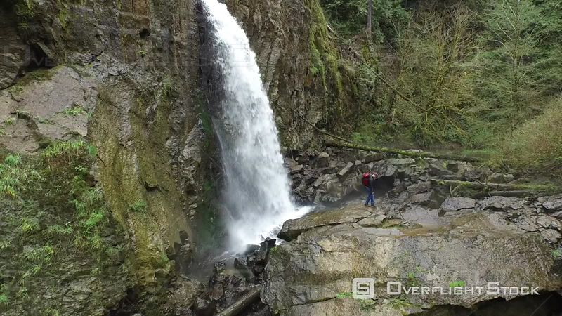 Aerial Footage of Backpacker Standing in Front of Waterfall Oregon USA