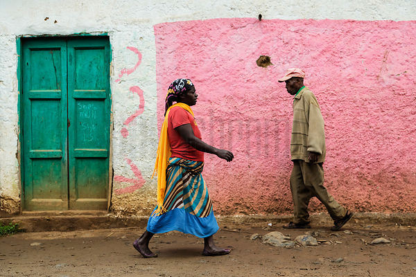 People Walking in front of a Pink Wall at Jinka Market