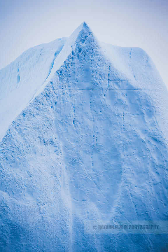 A triangular shaped iceberg pointing up in Ilulissat, Greenland