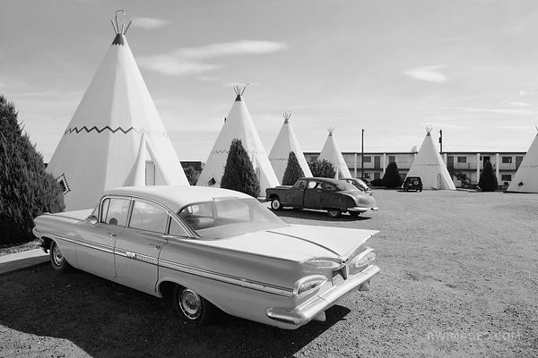 BLUE CHEVY AND THE WIGWAM MOTEL ROUTE 66 ARIZONA BLACK AND WHITE
