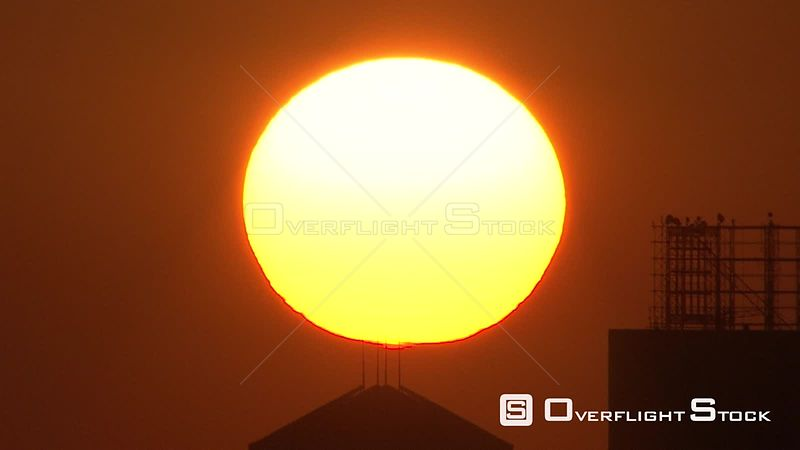 Aerial shot of the sun setting behind buildings Johannesburg Gauteng South Africa