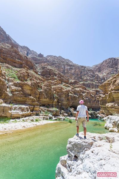 Tourist standing in Wadi shab canyon, Sur, Oman