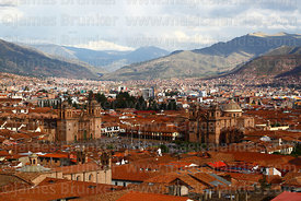 View of  Plaza de Armas in rainy season from Santa Ana district with cathedral (L) and La Compañia de Jesus church (R), Cusco...