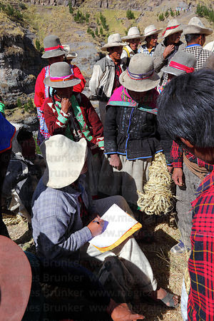 Community leader registering people who have provided new grass ropes to rebuild the bridge , Q'eswachaka , Canas province , ...