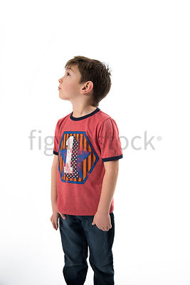 A boy in a retro t-shirt, looking up - shot from mid level.