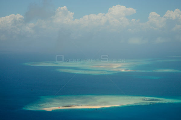 Aerial view of sand atolls and corals off the coast of the Island of Zanzibar, Tanzania
