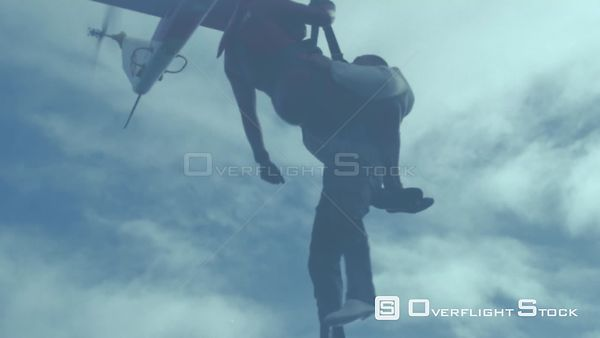 Low angle of two men being airlifted by a rescue helicopter Cape Town Western Cape South Africa