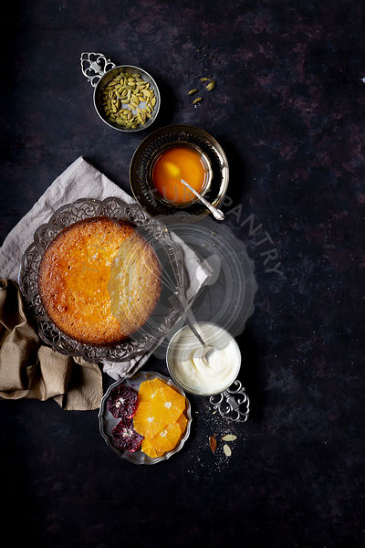 Whole orange olive oil cake with almond and cornmeal, finished with cardamom orange syrup - Gluten-free.