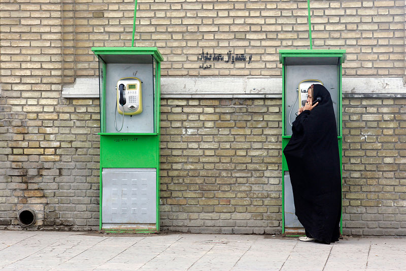 Iranian woman at public telephone, 11/04/07