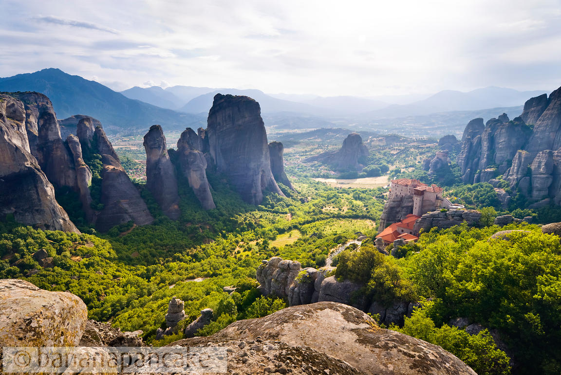 Meteora, Greece, with The Holy Monastery of Rousanou in the foreground.
