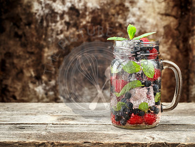 Fruit infusion drink with fresh berries in glass jars