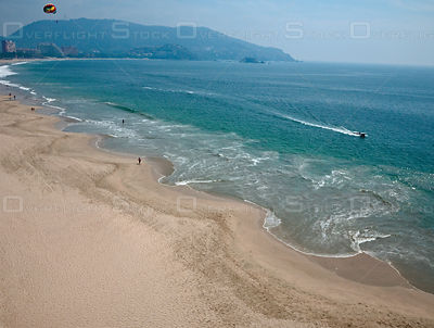 Parasailing. The beach looking south. Playa El Palmar, Ixtapa, Mexico